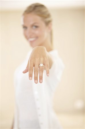 ring hand woman - I'm tying the knot Stock Photo - Premium Royalty-Free, Code: 613-08232949