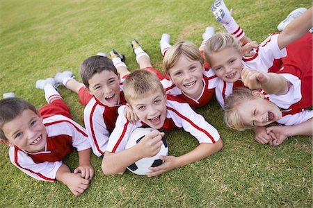 preteen boys playing - Enthusiastic about winning this season Stock Photo - Premium Royalty-Free, Code: 613-08233050