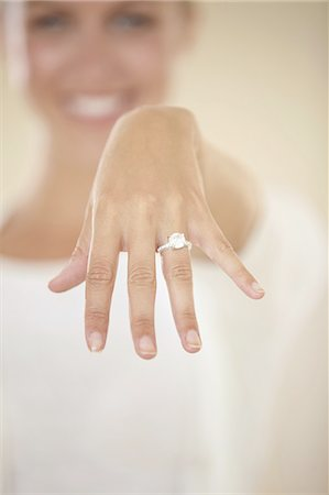 ring hand woman - We're tying the knot Stock Photo - Premium Royalty-Free, Code: 613-08233249