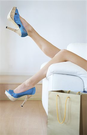 Taking a break from walking in heels Stock Photo - Premium Royalty-Free, Code: 613-08233397