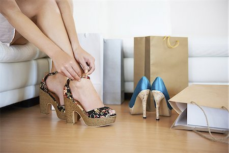 foot model - Fitting them on Stock Photo - Premium Royalty-Free, Code: 613-08233408