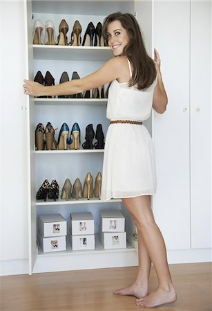Avid shoe collector Stock Photo - Premium Royalty-Free, Code: 613-08233401