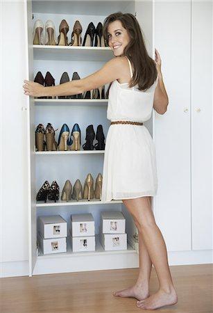 Avid shoe collector Stock Photo - Premium Royalty-Free, Code: 613-08233401