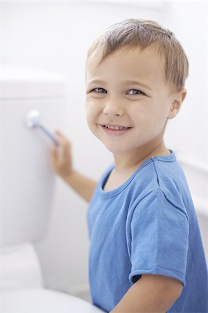 Flushing away mom's potty training worries Stock Photo - Premium Royalty-Free, Code: 613-08233570