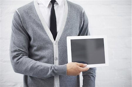 Copyspace on his tablet Stock Photo - Premium Royalty-Free, Code: 613-08233860