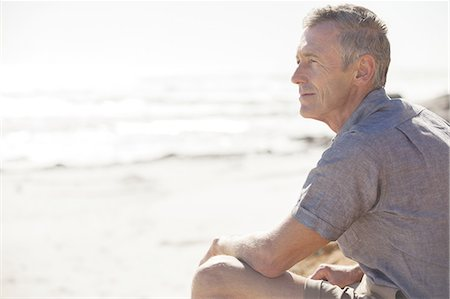 portrait looking away - Mature man relaxing on beach Stock Photo - Premium Royalty-Free, Code: 613-08242497