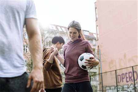 Woman Playing Urban Soccer Stock Photo - Premium Royalty-Free, Code: 613-08242583