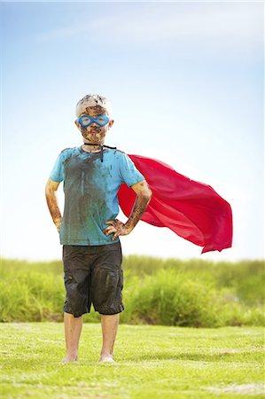 Pint-sized superhero Stock Photo - Premium Royalty-Free, Code: 613-08275256