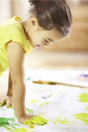 Unleashing her creative side Stock Photo - Premium Royalty-Free, Code: 613-08275269