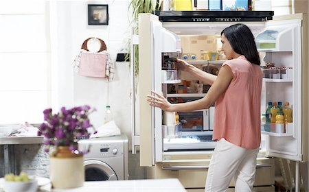 fridge - Woman looking in the fridge Stock Photo - Premium Royalty-Free, Code: 613-08276080
