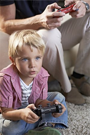 Intense gaming Stock Photo - Premium Royalty-Free, Code: 613-08276106