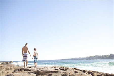 father son shirtless - Father and Son North Bondi rocks Stock Photo - Premium Royalty-Free, Code: 613-08386982