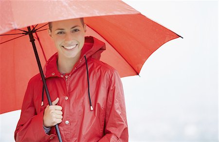 people with umbrellas in the rain - Feeling safe and protected Stock Photo - Premium Royalty-Free, Code: 613-08387085