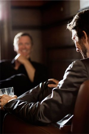 Two Businessmen sitting in a bar Stock Photo - Premium Royalty-Free, Code: 613-08387589