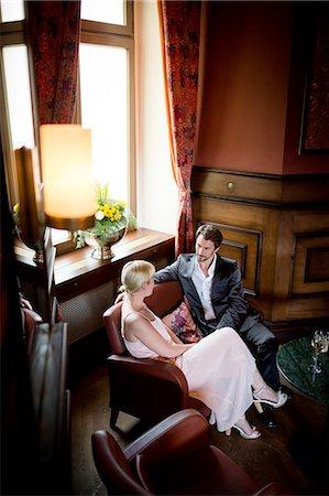 Man And Woman Flirting in Hotel Lobby Stock Photo - Premium Royalty-Free, Code: 613-08387580