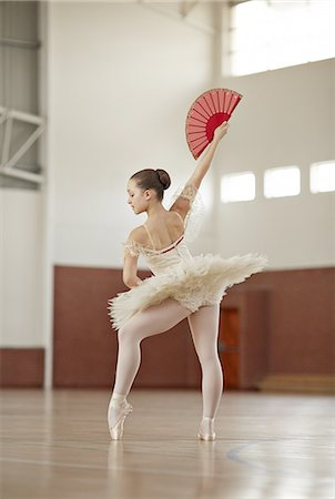 preteen dancing - Ballet girl posing in gymnasium Stock Photo - Premium Royalty-Free, Code: 613-08387729