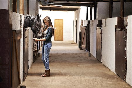 Taking a walk through the stables Stock Photo - Premium Royalty-Free, Code: 613-08390874