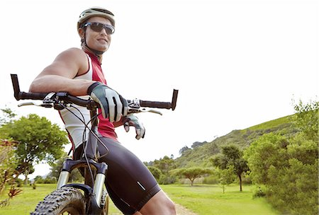 people mountain biking - Taking a quick stop to look at the view Stock Photo - Premium Royalty-Free, Code: 613-08391332