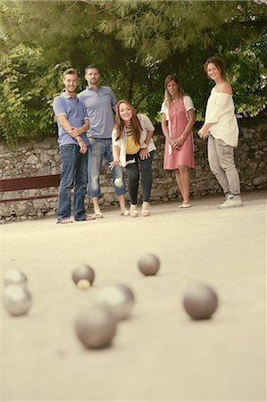 playing - Group of friends playing boule in France Stock Photo - Premium Royalty-Free, Code: 613-08391434