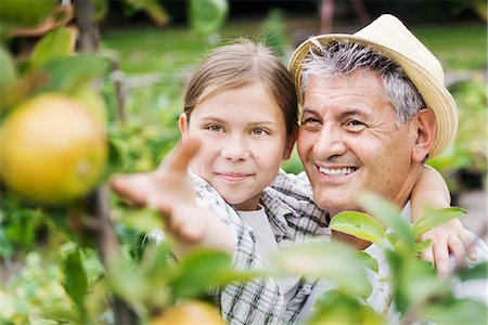 family apple orchard - Grandfather And Granddaughter Harvesting Apples Stock Photo - Premium Royalty-Free, Code: 613-08392224