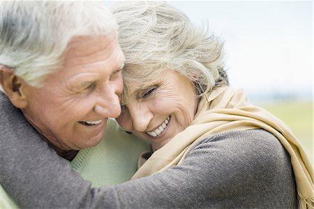Happy senior couple in park Stock Photo - Premium Royalty-Free, Code: 613-08519862