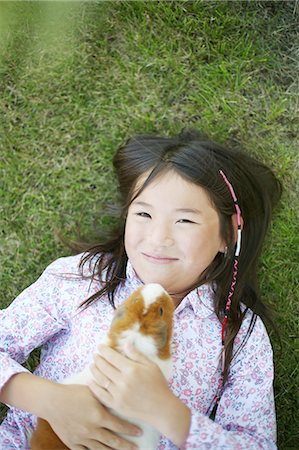 A girl hugging a hamster Stock Photo - Premium Royalty-Free, Code: 613-08519878