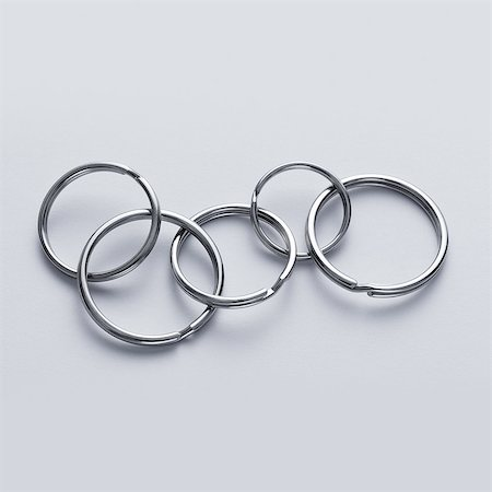 five - Connected key rings Stock Photo - Premium Royalty-Free, Code: 613-08525402