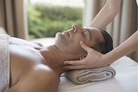 Enjoying a facial massage Stock Photo - Premium Royalty-Free, Code: 613-08525905