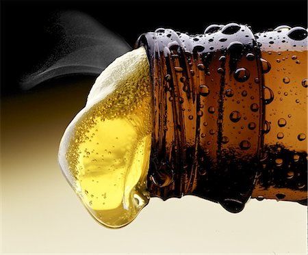 pouring - Beer Pouring from Beer Bottle Stock Photo - Premium Royalty-Free, Code: 613-08526448