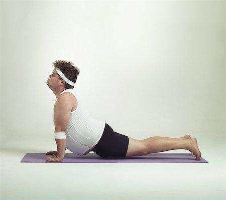 fat man exercising - This upward facing dog pose is great Stock Photo - Premium Royalty-Free, Code: 613-08526464