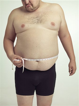 Okay maybe i have gained a little weight Stock Photo - Premium Royalty-Free, Code: 613-08526539