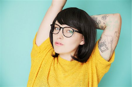 Young hipster woman with tattoos in bright colours Stock Photo - Premium Royalty-Free, Code: 613-08527303