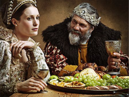 He's feasting and his goblet is full...again! Stock Photo - Premium Royalty-Free, Code: 613-08557425