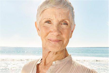 Senior woman on the beach, portrait Stock Photo - Premium Royalty-Free, Code: 613-08747194