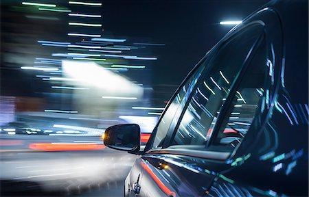 on board a driving car - car's side in foreground Stock Photo - Premium Royalty-Free, Code: 613-08741853
