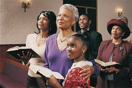 Family Standing in Church Pews Holding Bibles and Listening to a Service Stock Photo - Premium Royalty-Free, Code: 613-00455836