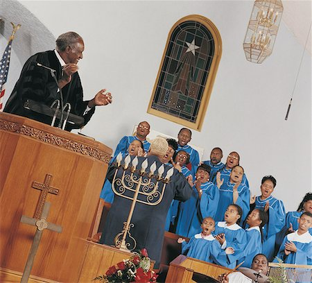 Gospel Choir Singing and Clapping During a Church Service Stock Photo - Premium Royalty-Free, Code: 613-00455832