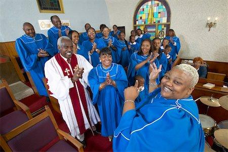 Gospel Singer Leading a Choir in a Church Service Stock Photo - Premium Royalty-Free, Code: 613-00624654