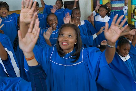 Congregation of Gospel Singers With Raised Hands Singing in a Church Service Stock Photo - Premium Royalty-Free, Code: 613-00624653
