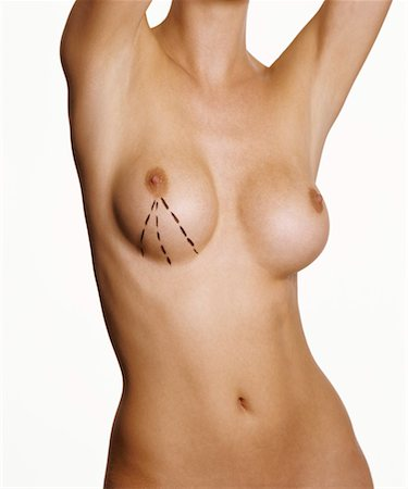 Naked Woman with Her Arms Up and Markings Around Her Breast Stock Photo - Premium Royalty-Free, Code: 613-00627207