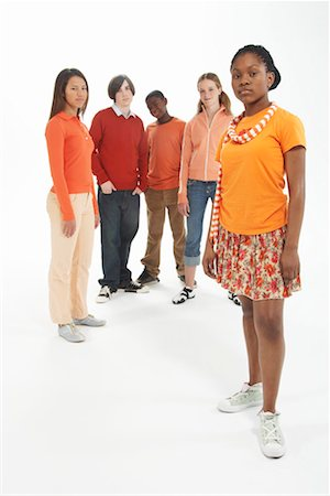 female white background full body - Group of teenagers (14-16), one girl standing forward, portrait Stock Photo - Premium Royalty-Free, Code: 613-00814065