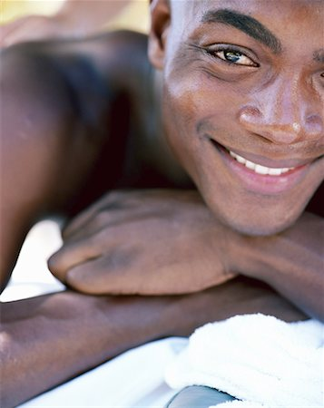 Man receiving back massage, smiling, portrait, close-up Stock Photo - Premium Royalty-Free, Code: 613-00811155