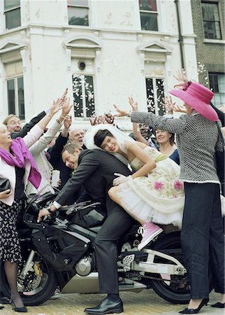 family image and confetti - Wedding guests throwing confetti over bride and groom on motorbike Stock Photo - Premium Royalty-Free, Code: 613-00863457