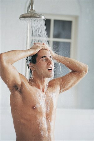 Young Man Having a Shower Stock Photo - Premium Royalty-Free, Code: 613-00963035