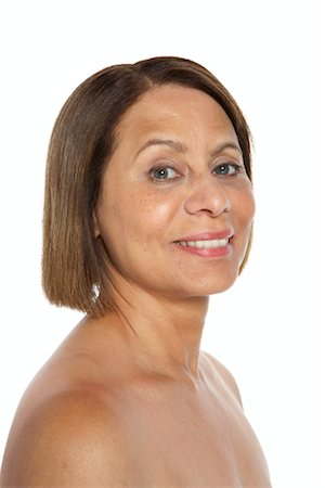 Mature woman smiling, portrait Stock Photo - Premium Royalty-Free, Code: 613-01035946