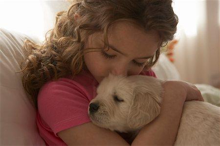 dog kissing girl - Girl (8-10) kissing dog Stock Photo - Premium Royalty-Free, Code: 613-01125231