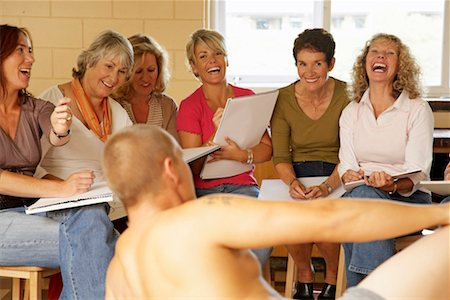 Mature women in life drawing class, smiling and laughing at male model Stock Photo - Premium Royalty-Free, Code: 613-01169202