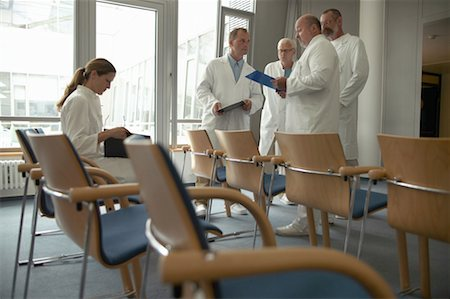 Group of doctors gathered in waiting room Stock Photo - Premium Royalty-Free, Code: 613-01169212