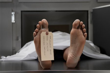 dead female body - Cadaver on autopsy table, label tied to toe, close-up Stock Photo - Premium Royalty-Free, Code: 613-01287058