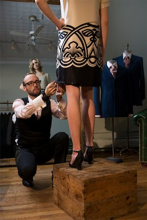 Tailor pinning female model's skirt, model with hand on hip Stock Photo - Premium Royalty-Free, Code: 613-01289010